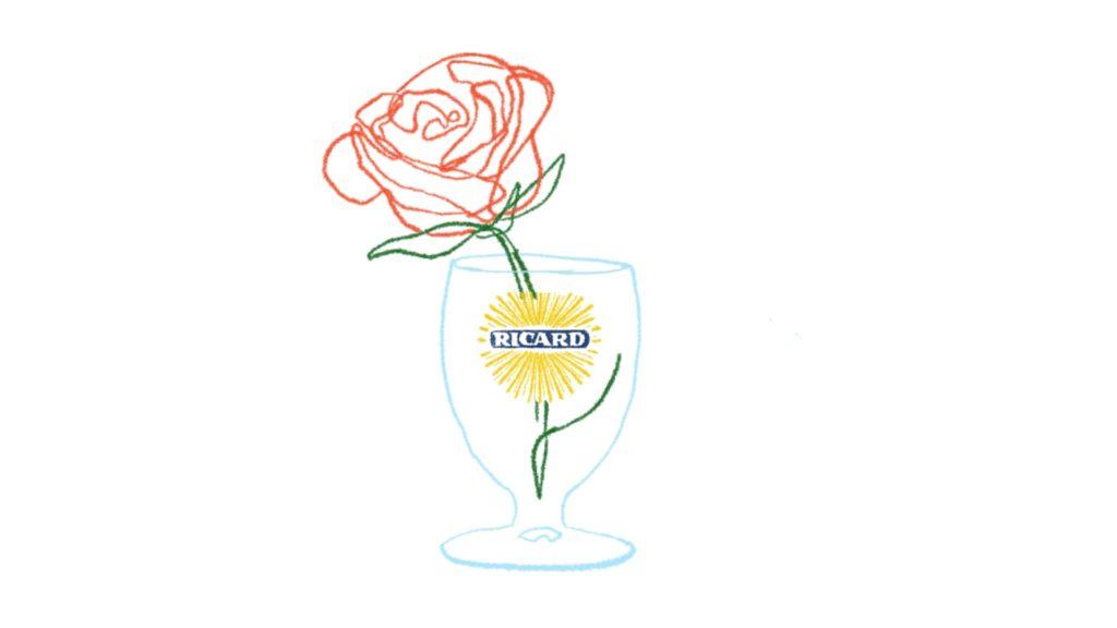 Une rose dans un verre de Ricard